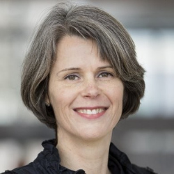 Esther Schmal woman medium short hair brown and grey smiling