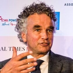 Dutch white man curly black and grey hair suit talking