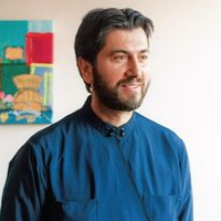 Antonios Papanikolaou Greek Orthodox priest short hair beard black robe